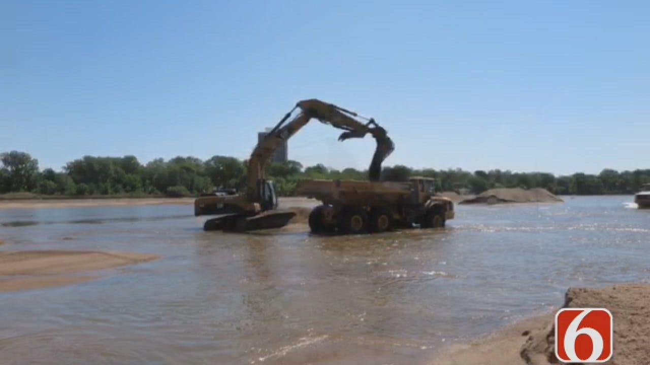 Emory Bryan: Construction Crew Races To Move Sand In Arkansas River Bed