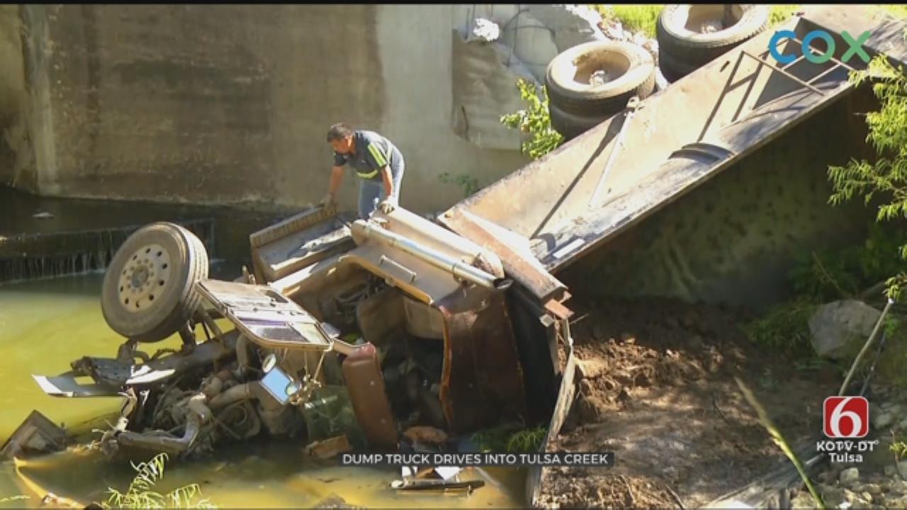 Dump Truck Crashes Into South Tulsa Creek