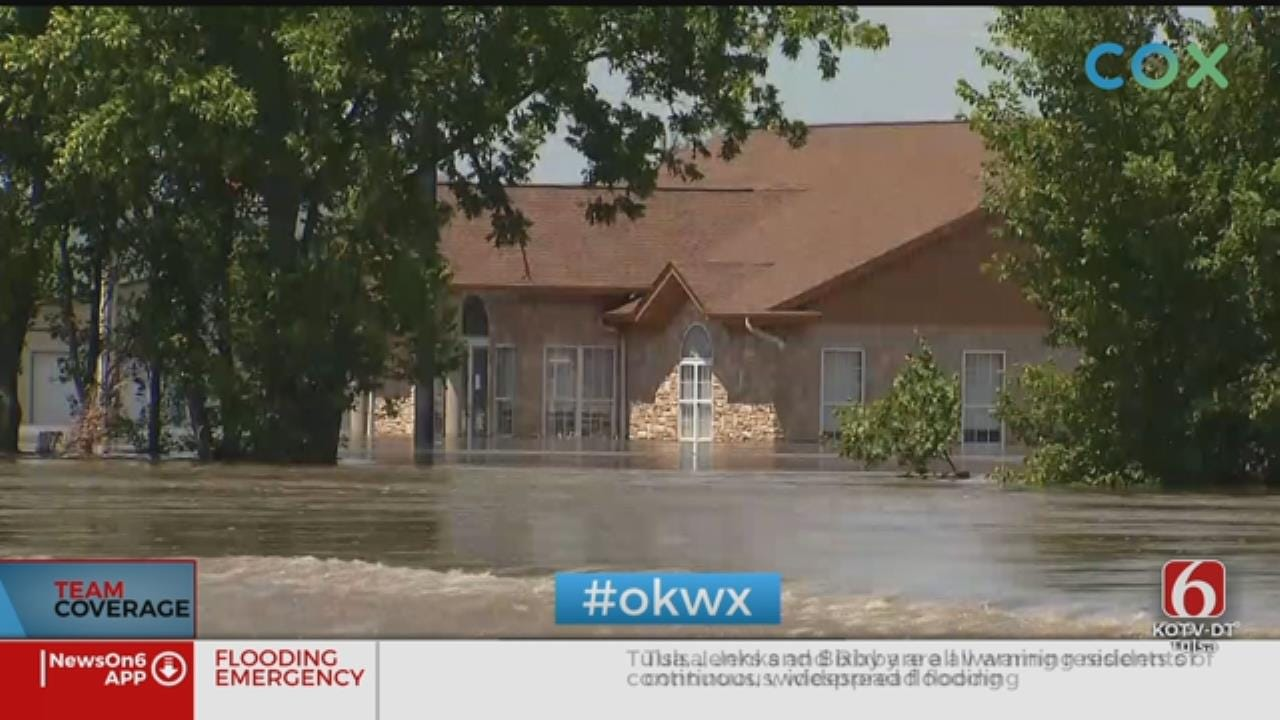 Braggs Still Cut Off By Flooding As Donations Come In On Boats