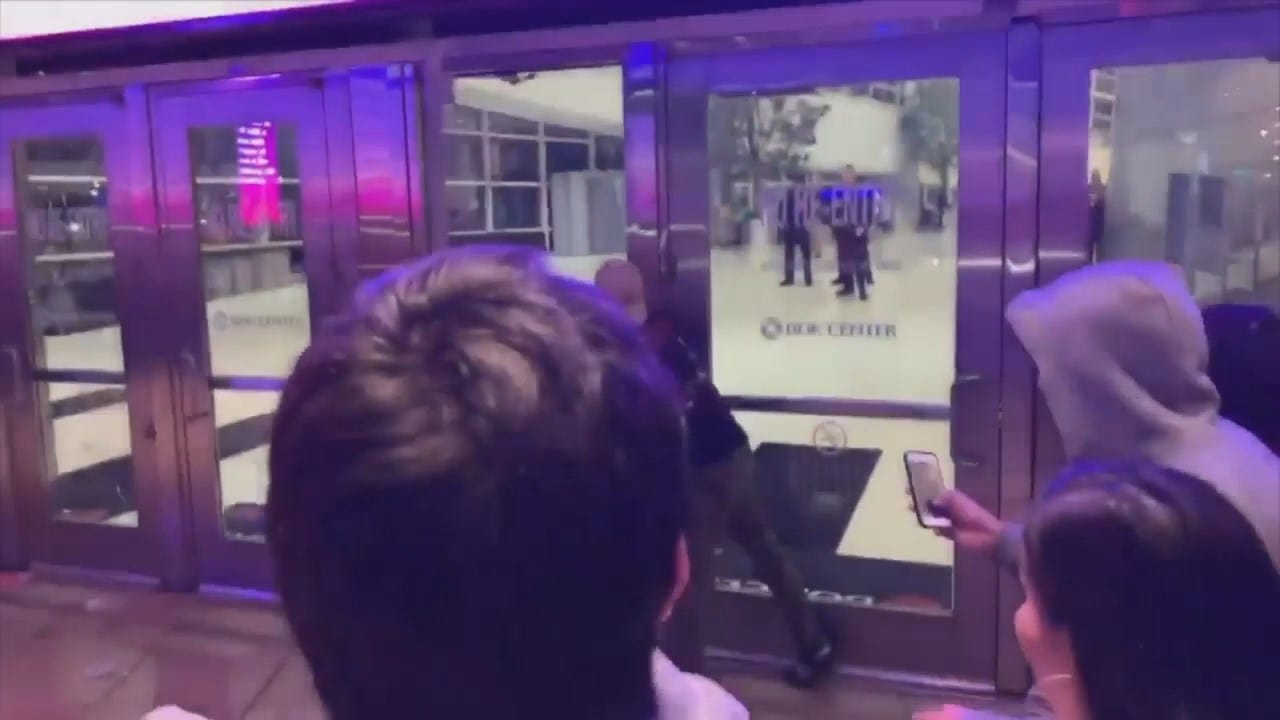 WATCH: Frustrated Travis Scott Fans Pound On Doors After Concert Postponed