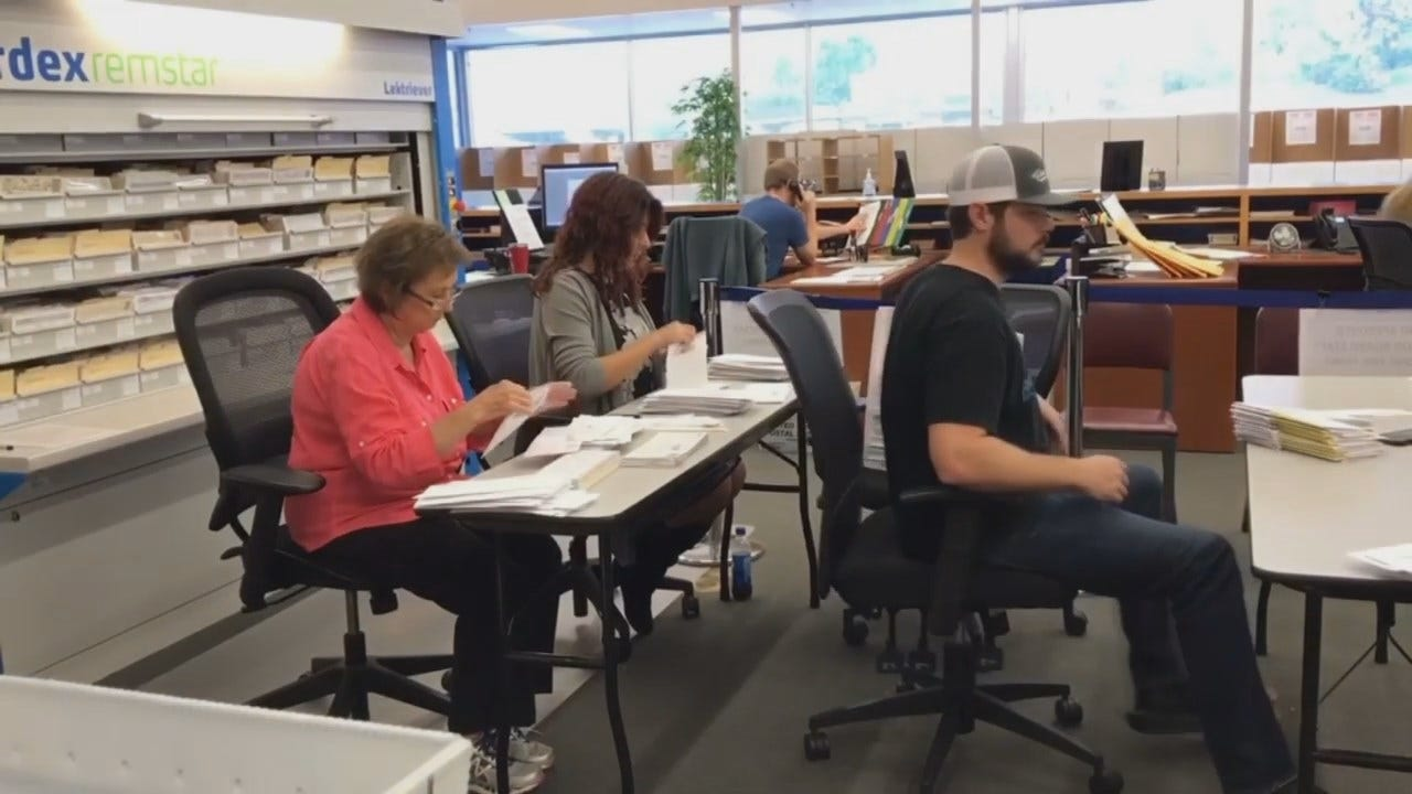 WEB EXTRA: Tulsa County Election Board Workers Counting Absentee Ballots