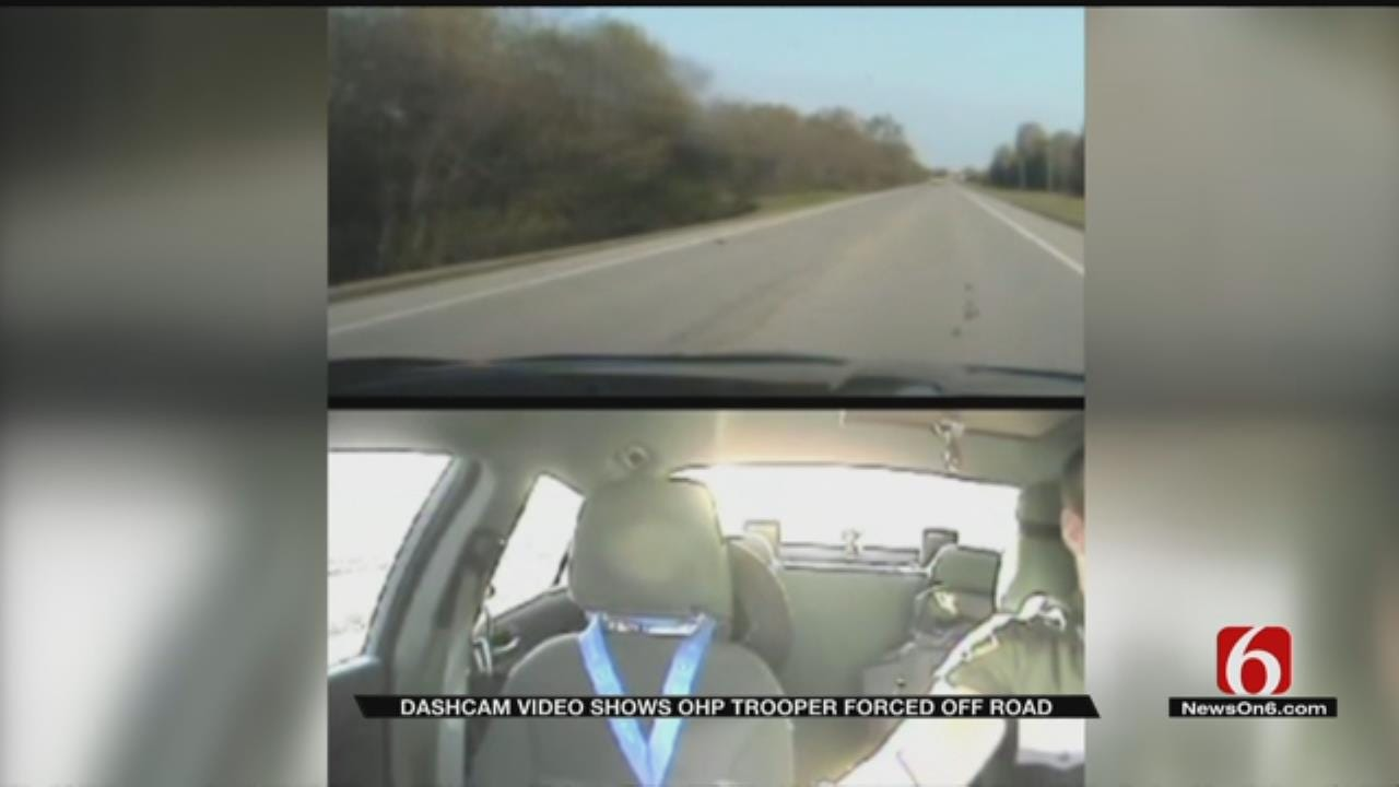 Dash Cam Video Shows Moment OHP Trooper Forced Off Road At High Speed