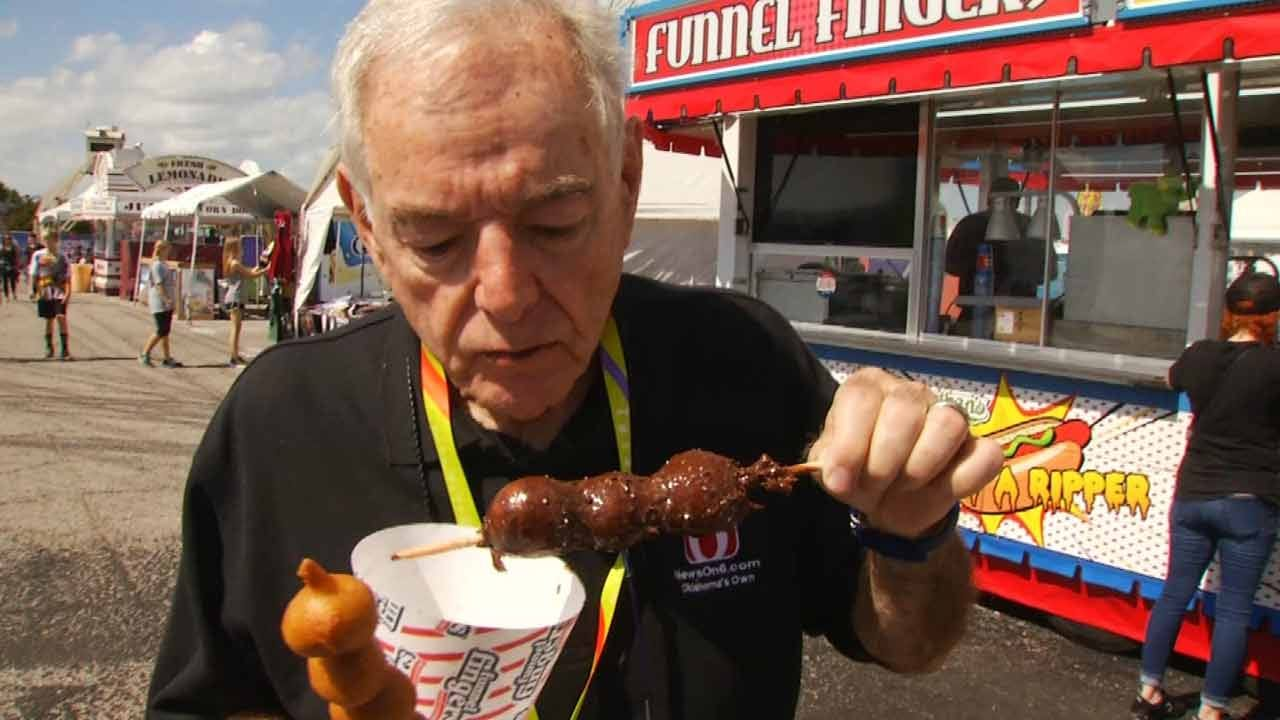 Rick Wells Tries Out The Food At The Tulsa State Fair