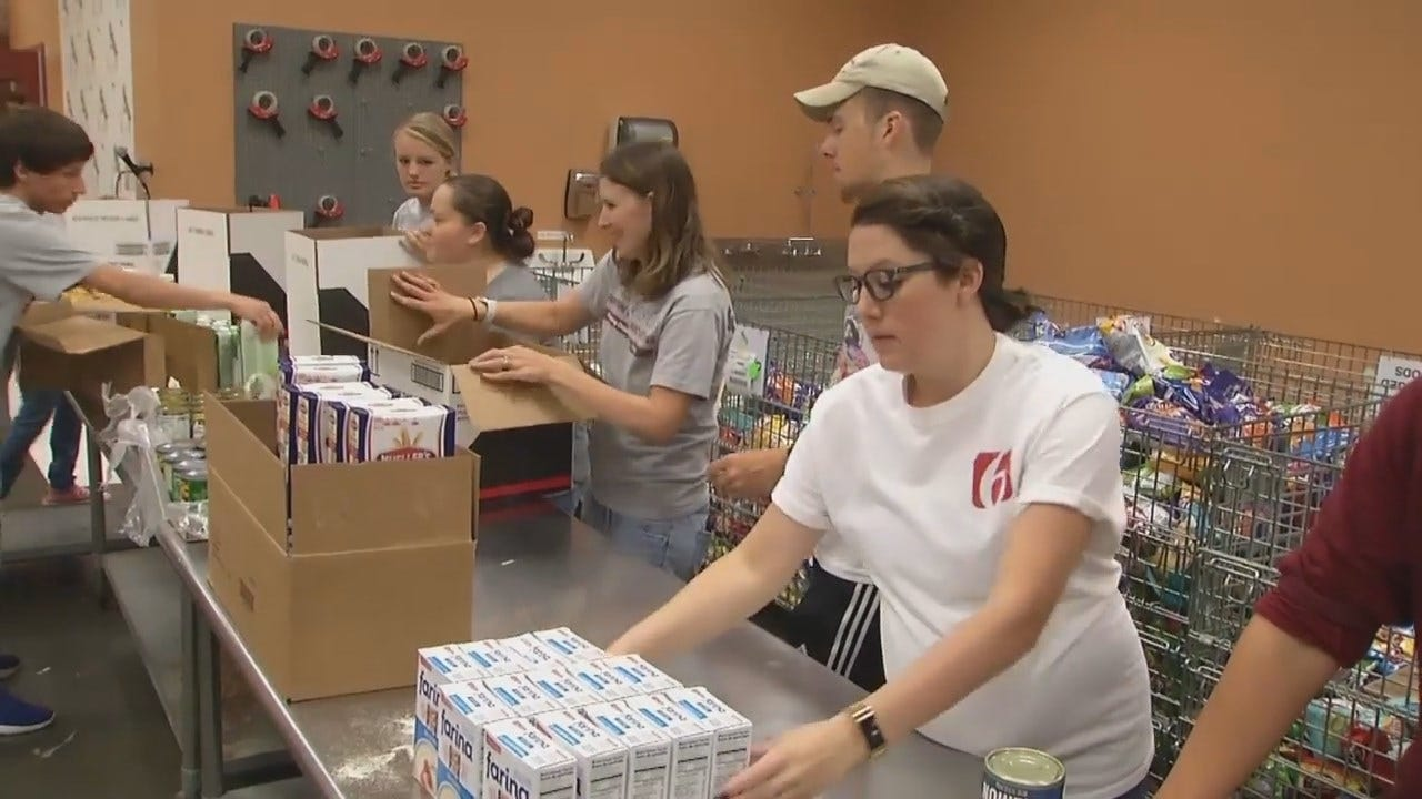 WEB EXTRA: News On 6 Volunteers Packing 'Food For Kids' Meal Boxes