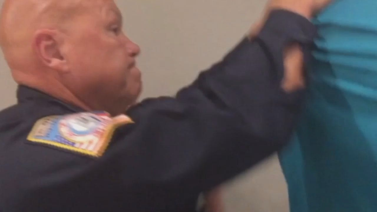 WEB EXTRA: Video Of Man's Removal From Rogers County Forum