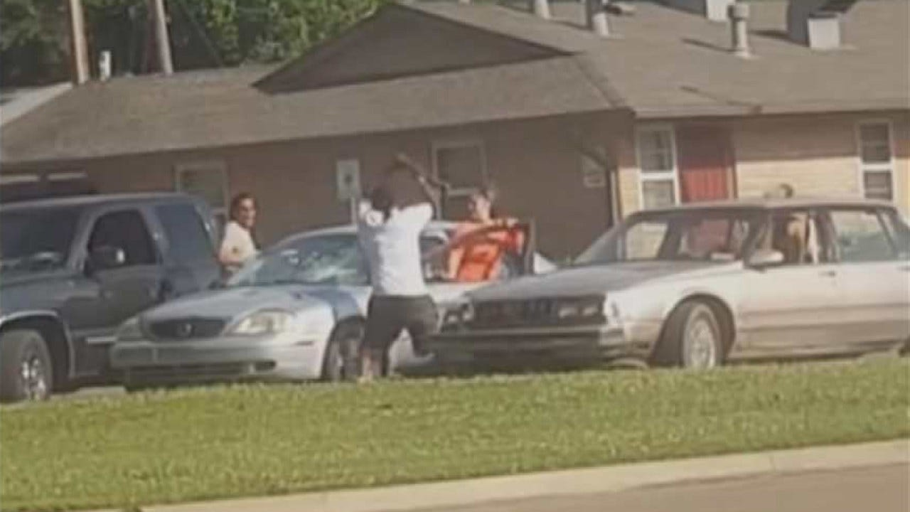 Cell Phone Video Of Man Hitting Cars With Ax