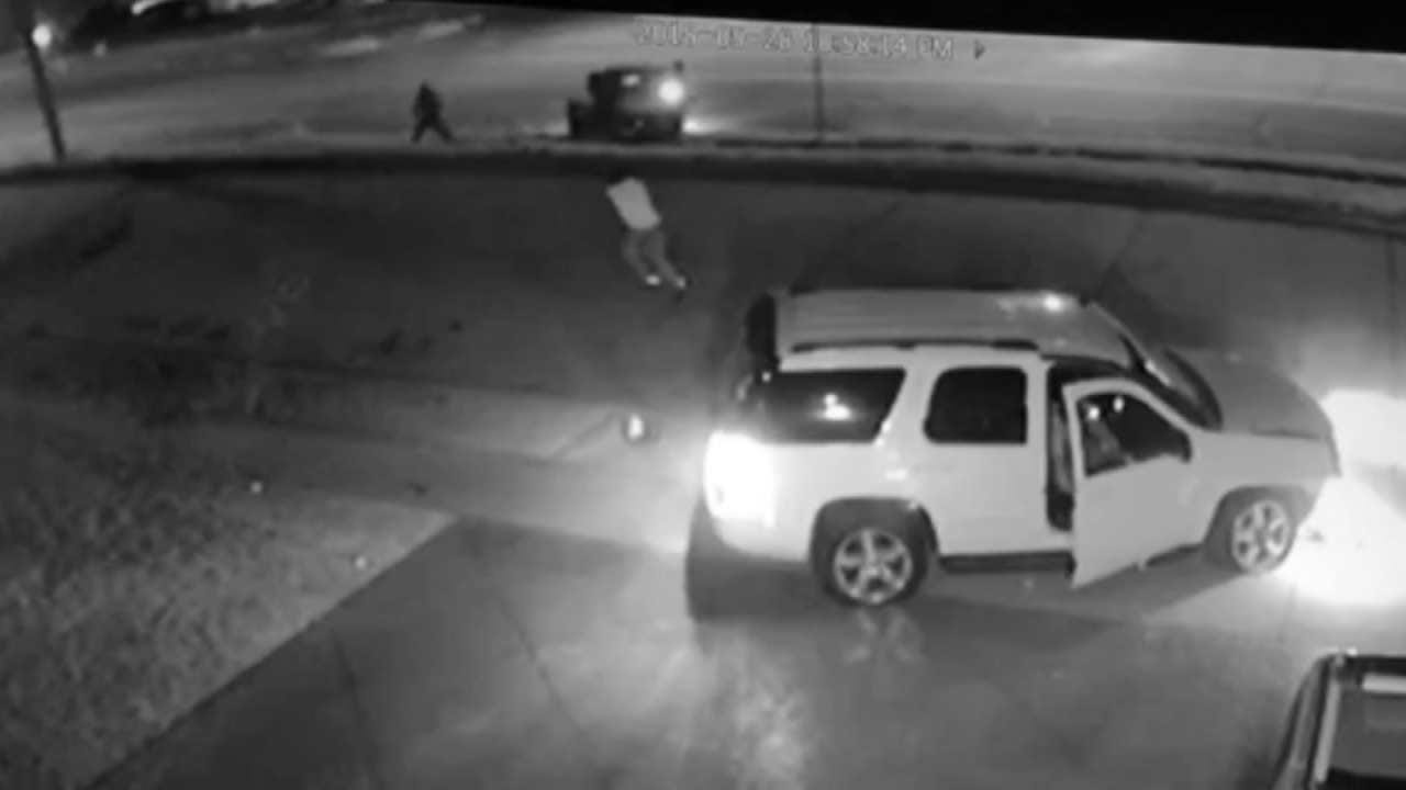 Surveillance Video: Bystander Hit When SUV Driver Opens Fire After Tulsa Chase
