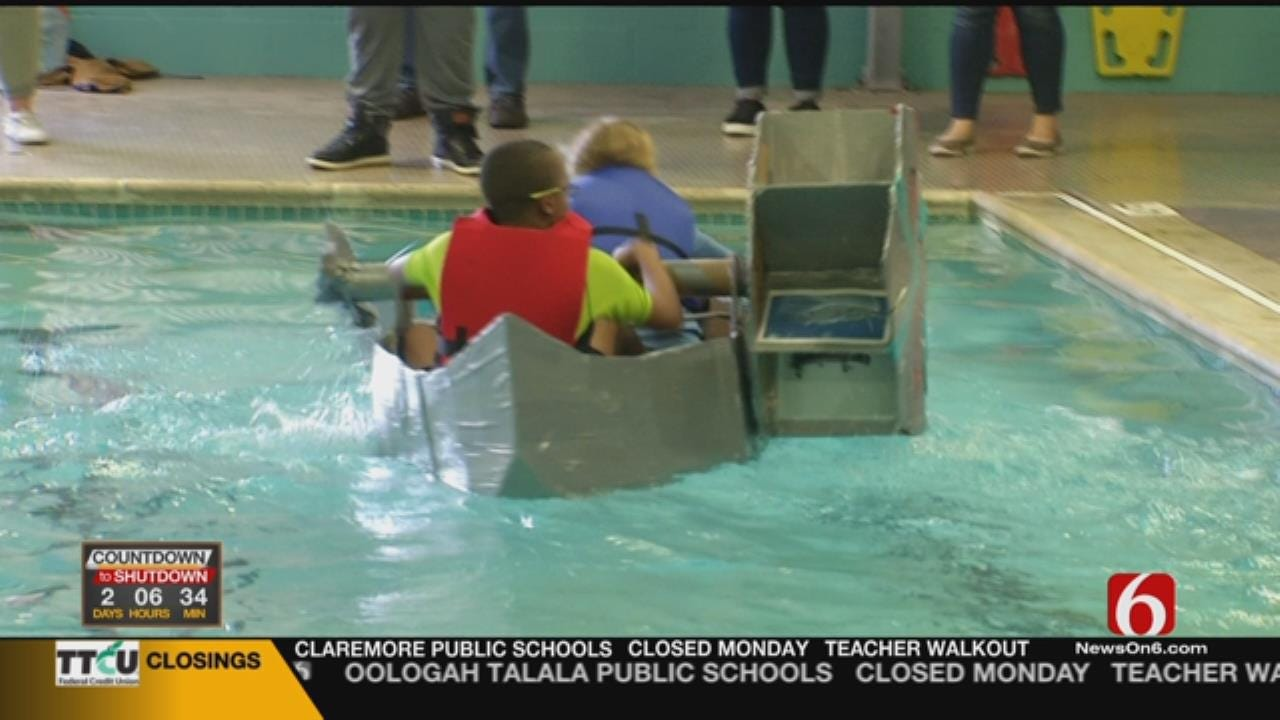 OK Students Use STEM Skills To Build Cardboard, Duct Tape Boats
