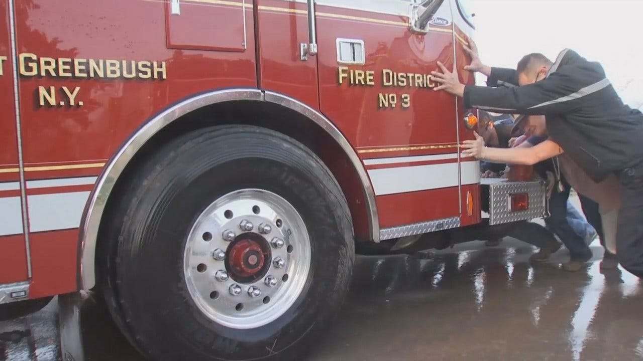 WEB EXTRA: Mounds Firefighters Push New Fire Truck Into Station