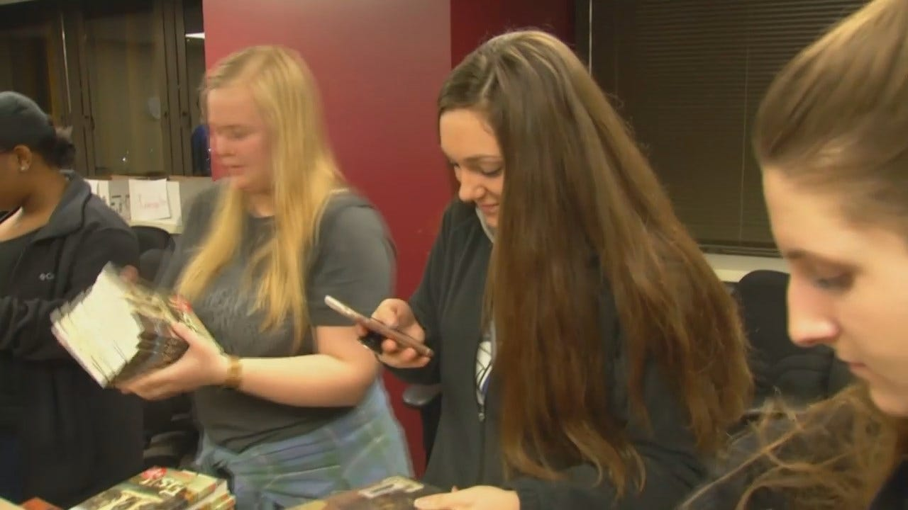 WEB EXTRA: Video Of ORU Students Sorting Through Book Donations