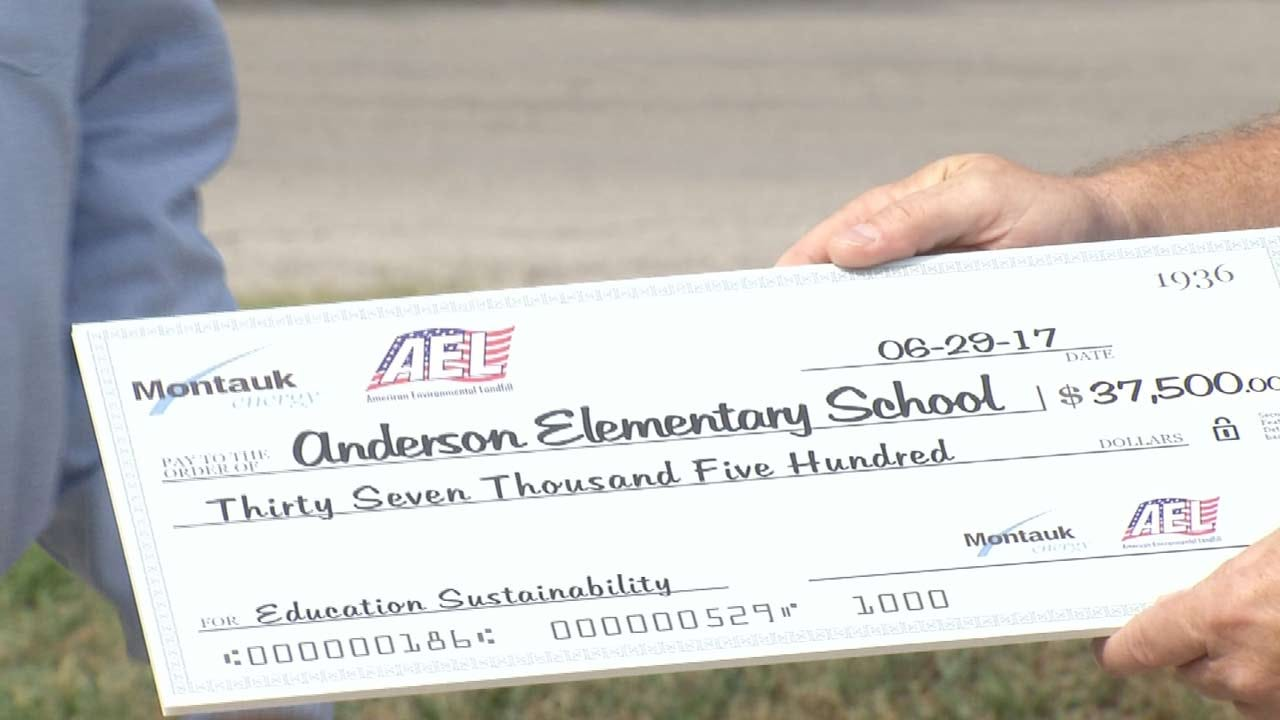 Businesses Give Donation To Sand Springs Elementary School
