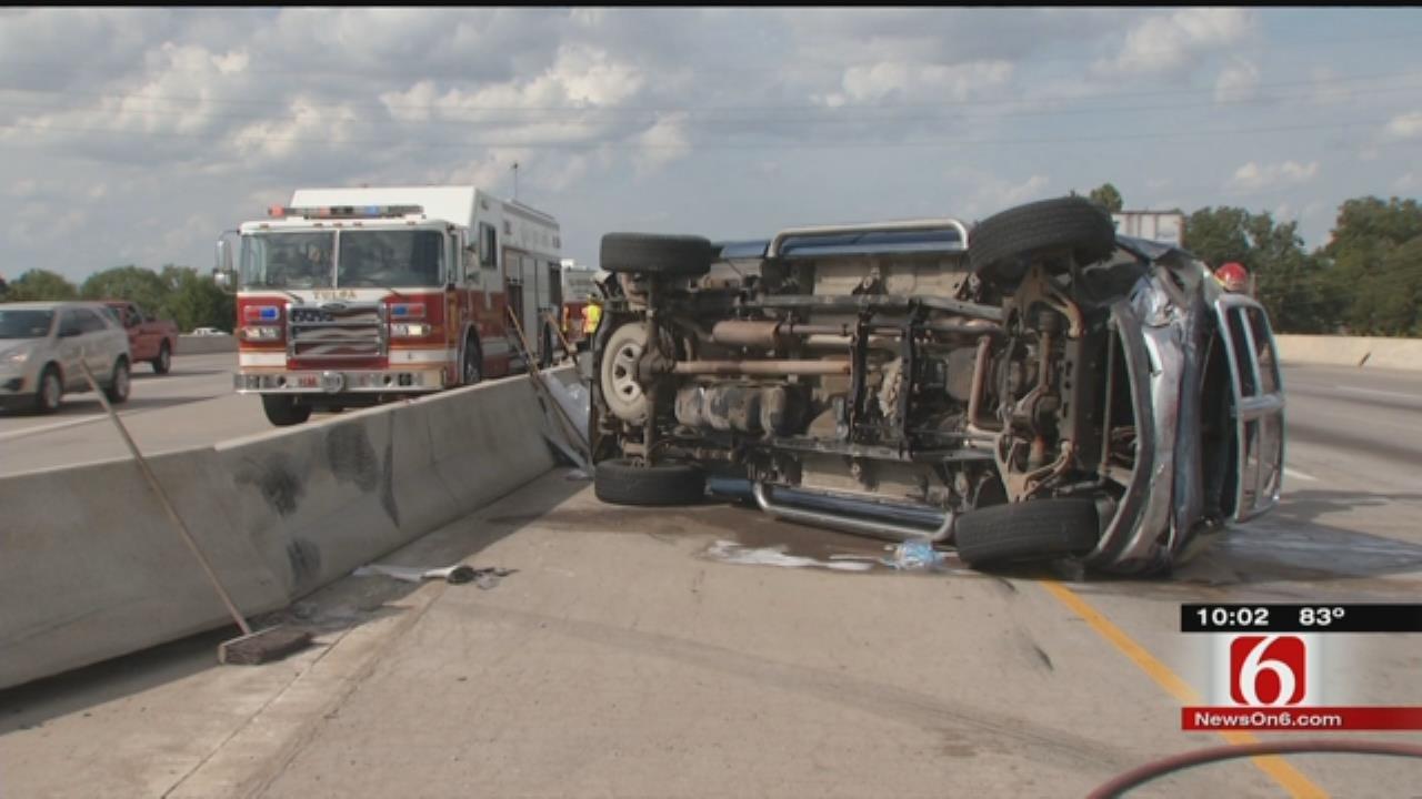 Overturned Truck Damages U.S. 169 Concrete Barrier; Occupants Flee