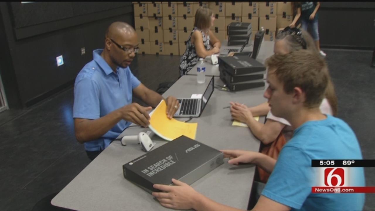 Broken Arrow School District Gives Laptops To Ninth Graders