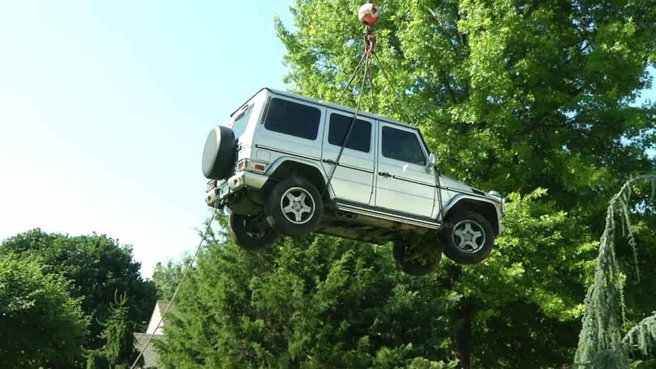 WEB EXTRA: Crane Lifts Mercedes Out Of Tulsa Koi Pond