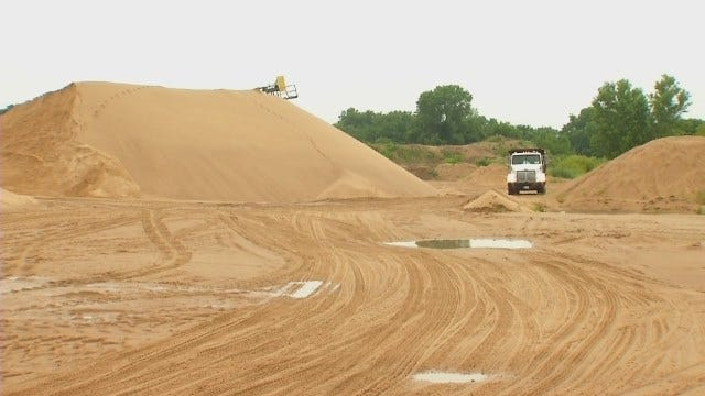 WEB EXTRA: Video of Wagoner County Trucks Loaded With Sand