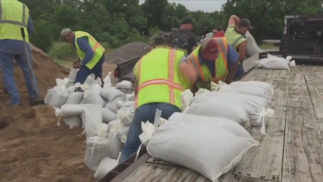 WEB EXTRA: Workers In Okmulgee County Filling And Loading Sand Bags
