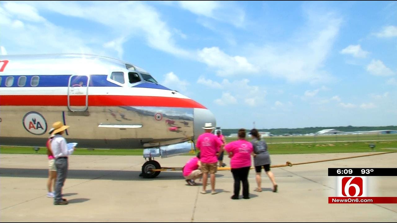 Teams Pull A Plane For Green Country Charity