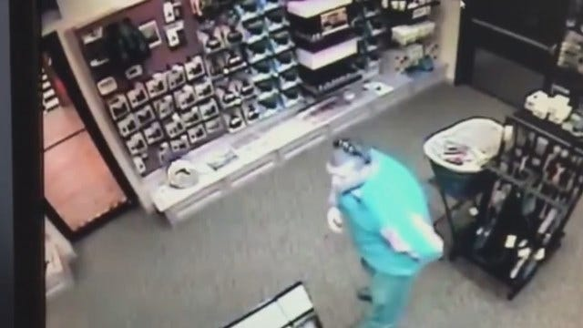 WEB EXTRA: Video Of Men Taking Gun From Store