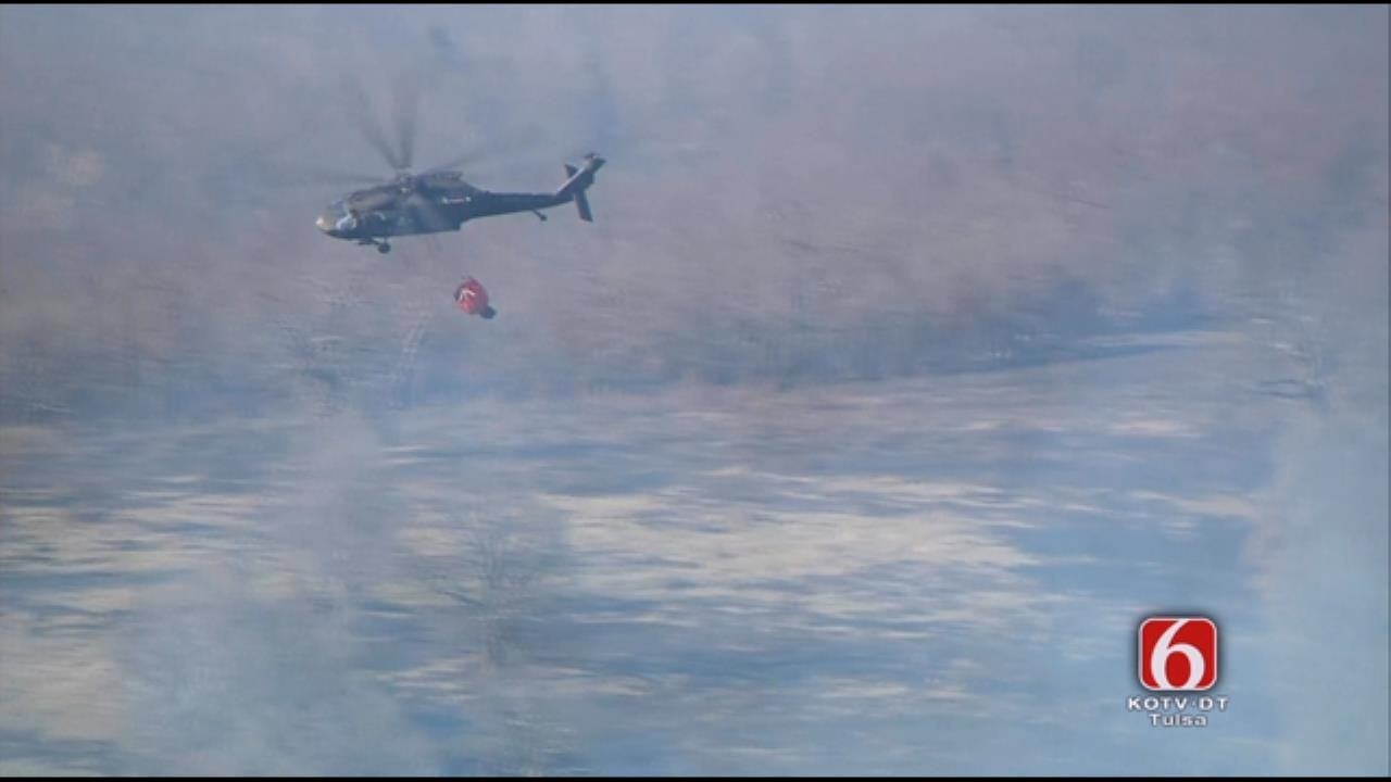 WEB EXTRA: Black Hawk Helicopter Dumps Water On Skiatook Fire