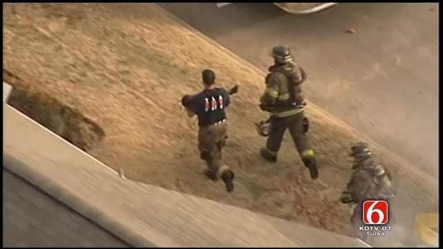 Osage Skynews 6: Tulsa Firefighters Carry Child From Burning Apartment