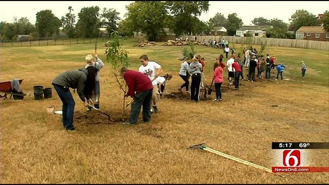 Holland Hall Students Plant Trees At Tulsa Housing Complex