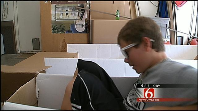 Boy Scout, His Grandpa Prepare For Cardboard Boat Races