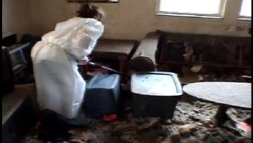 WEB EXTRA: Animal Control Workers Corral Dogs Found Amid Trash Near Claremore Home