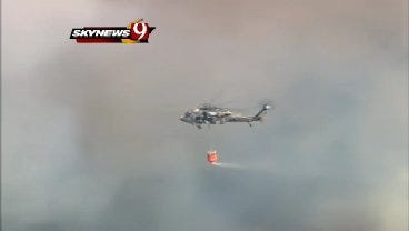 WEB EXTRA: SkyNews9 Captures Helicopter Dropping Water On Grassfire Near Harrah