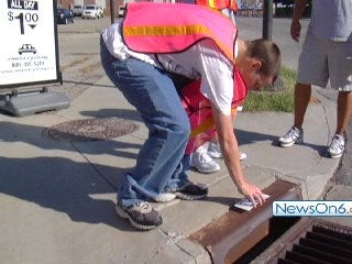 Volunteers Try to Keep it Out of the Gutter