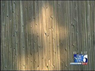 Sunlit Cross Appears On Broken Arrow Fence In The Springtime
