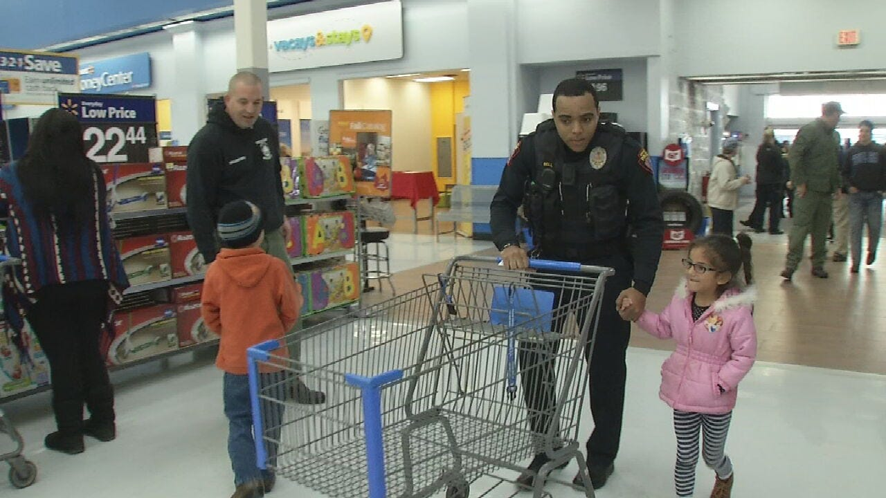 Police Officers Bring Some Christmas Cheer During 'Shop With A Cop' Event