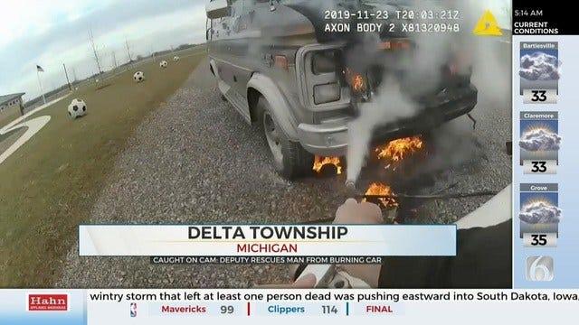 Michigan Deputy Saves Man From Burning Car