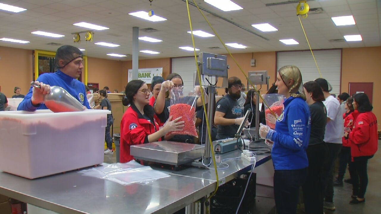 Route 66 Marathon Runners From Russia Volunteer At Oklahoma Food Bank