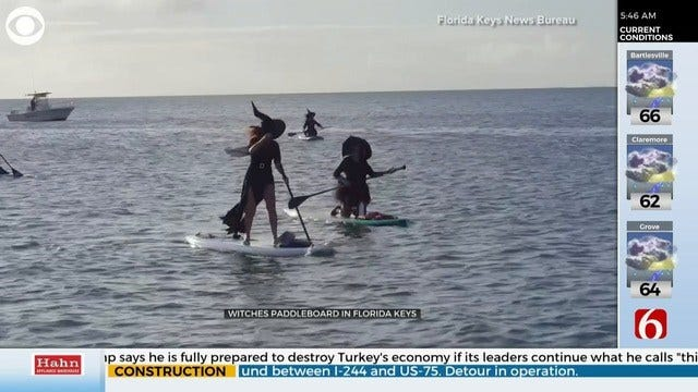 WATCH: Group of Witches, Warlocks Trade Brooms For Paddleboards