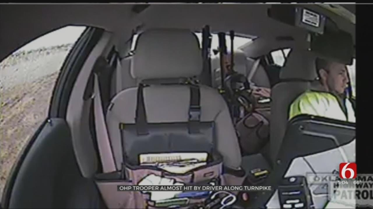 WATCH: Driver Hydroplanes, Nearly Hits OHP Trooper