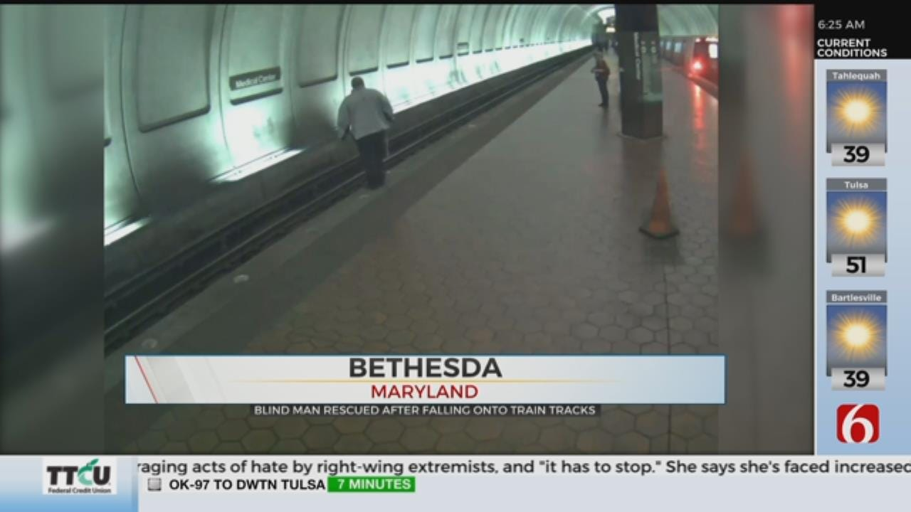 WATCH: Blind Man Rescued From Fall Onto Subway Train Tracks