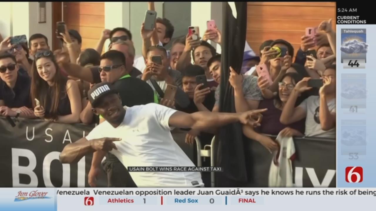 Usain Bolt Races Three-Wheeled Taxi