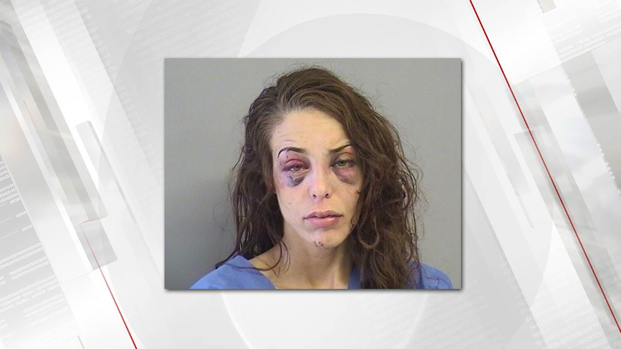 Bixby Woman Accused Of Assaulting Officers With Knives, Bat