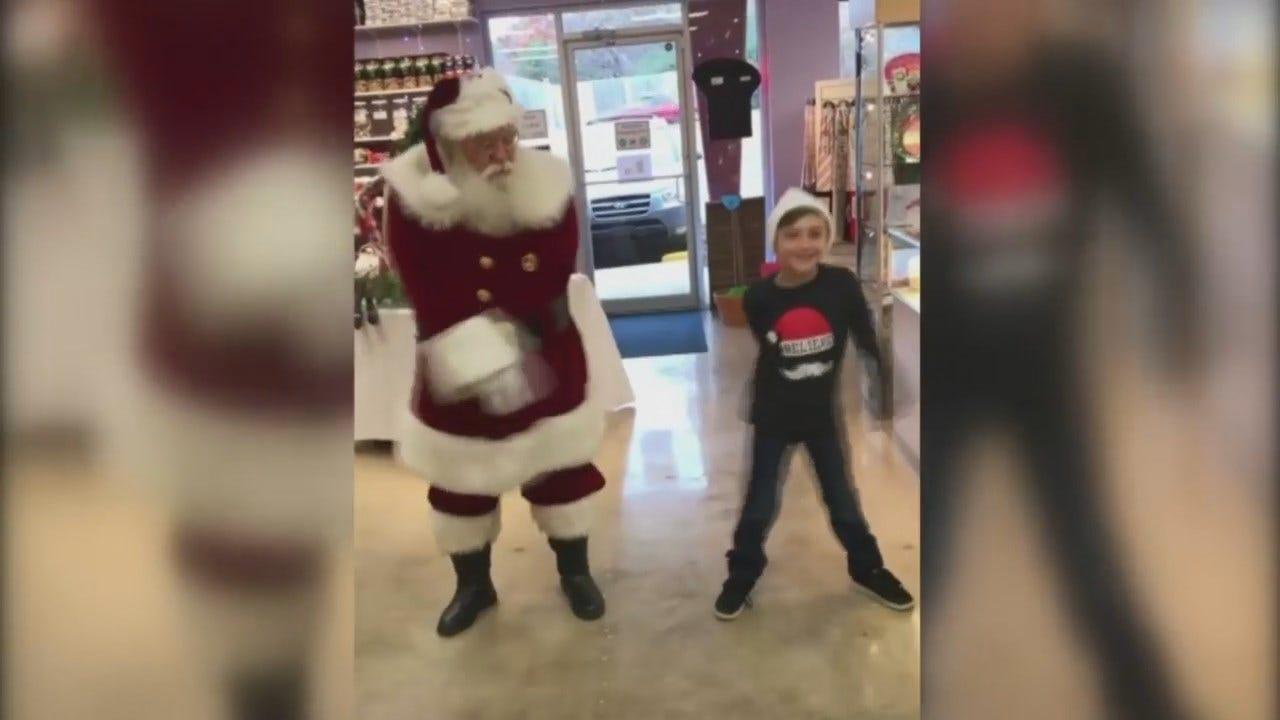 WATCH: Tulsa Boy Teaches Santa To Floss
