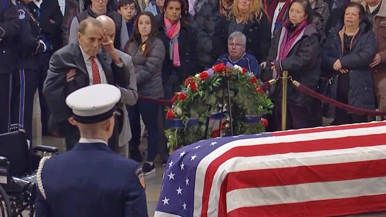 Bob Dole Rises From Wheelchair To Salute President George H.W. Bush