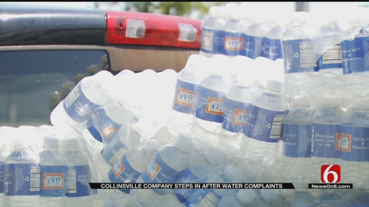 Company Donates Cases Of Water To Collinsville Residents