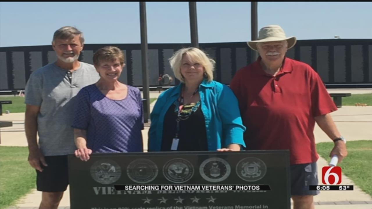Man Searching For Pictures Of Oklahoma Veterans On Vietnam Memorial Wall