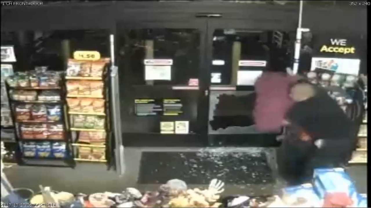 SURVEILLANCE: Employee Bear Hugs Masked Man To Stop Tulsa Store Robbery