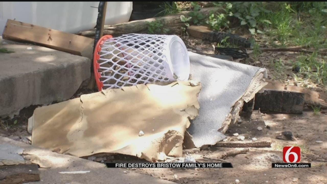 Family Returns Home To Destroyed House After Fire