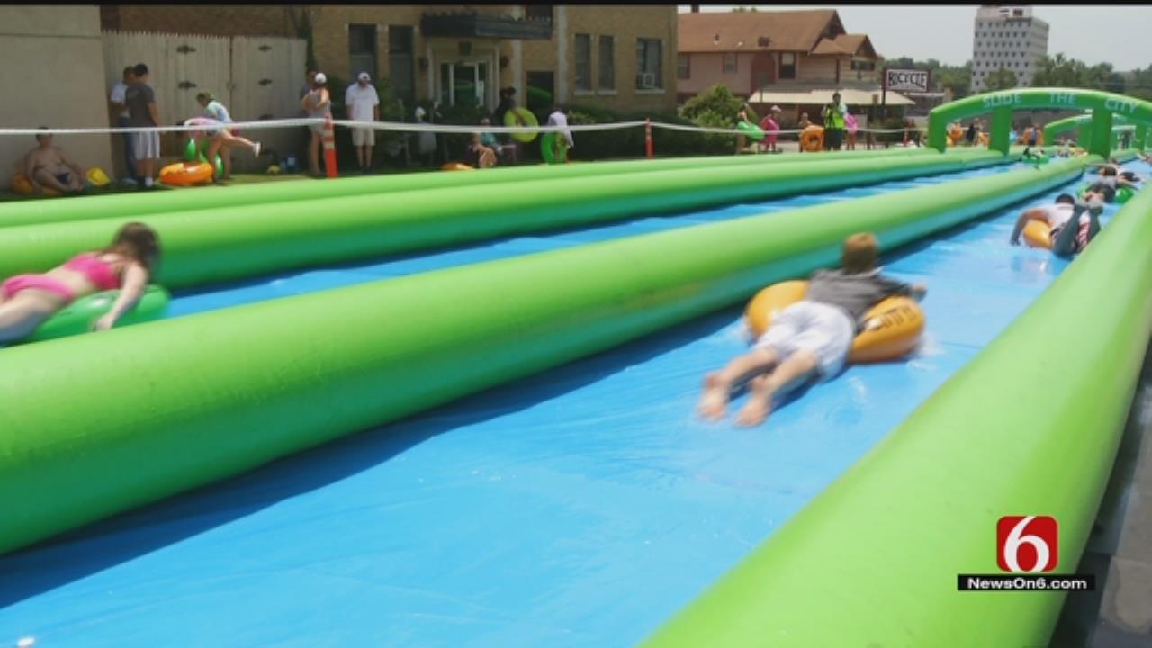Hundreds Cool Down By Sliding Down Tulsa's Main Street