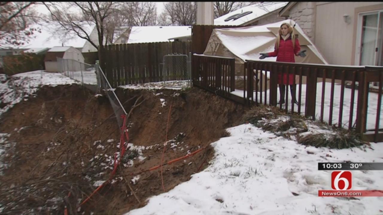 As Rain Falls, BA Family's Yard Washes Away