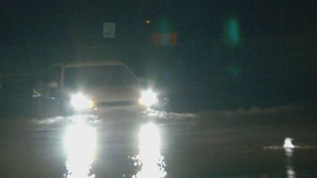WEB EXTRA: Broken Water Line Caused Flooding; Vehicles Struggle Through