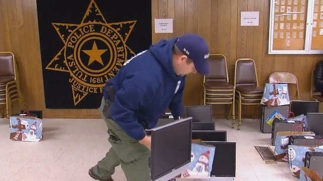WEB EXTRA: Video Of Tulsa Police Officers Delivered Computers