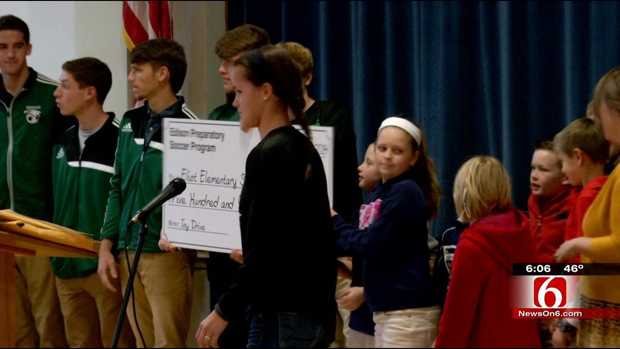 High School Soccer Team Donates To Tulsa Elementary School