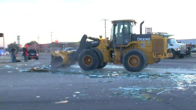 WEB EXTRA: Broken Mirror Glass Cleaned Up At East Tulsa Intersection